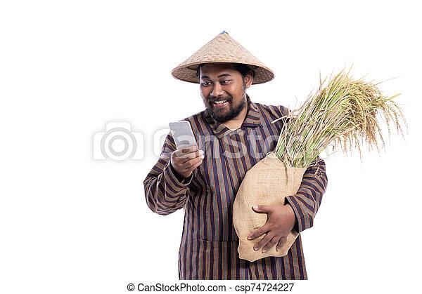 aus, beweglich, asiatisch, landwirt, telefon, weißes, freigestellt, gebrauchend - csp74724227