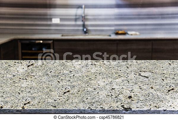 Schließen Sie den Küchentisch mit verschwommenem Küchenhintergrund. - csp45786821