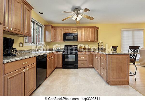 Küche mit schwarzen Geräten - csp3393811