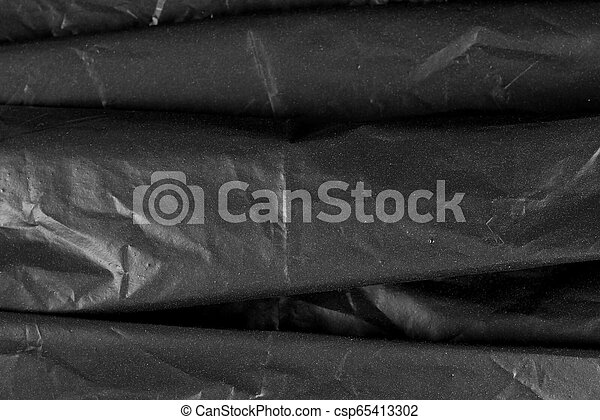 Abstract Hintergrund-Crumpled Plastik Film Textur schwarzer Müllbeutel - csp65413302